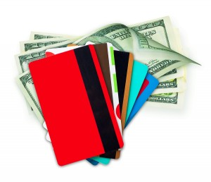 Money cash and credit, discount cards isolated on a white backgr